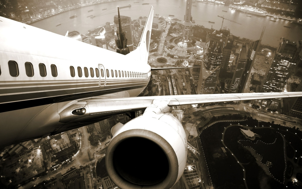 city-airplane-take-off-the-river-drive-windows