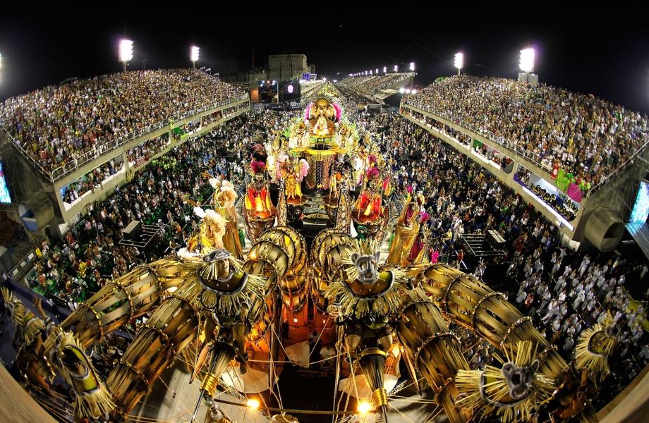 Revellers attend to XXXXXXXX Samba School parade during Rio de Janeiro's carnival on Marques de Sapucai Sambodromo.