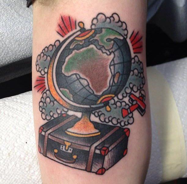 Globe and suitcase tattoo