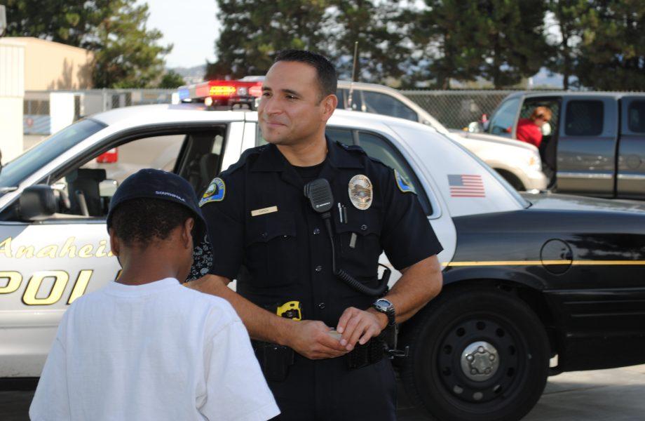 Cop rescuing a child - representative image