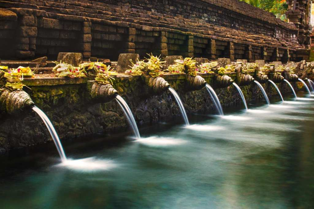 Rituals at Tirta Empul Temple for soul purification