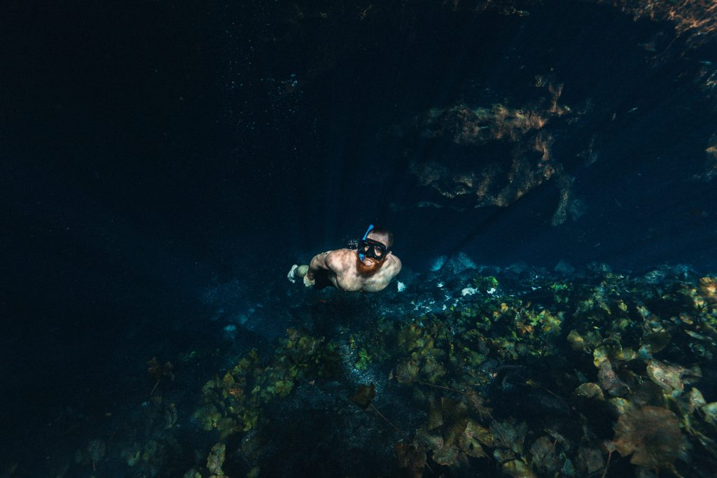A man doing snorkelling under water in Singapore