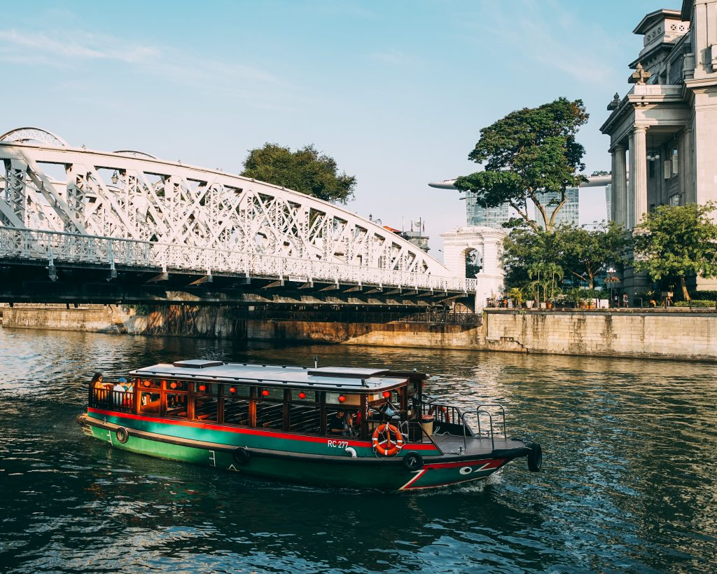 A bumboat carrying tourists around the anderson bridge