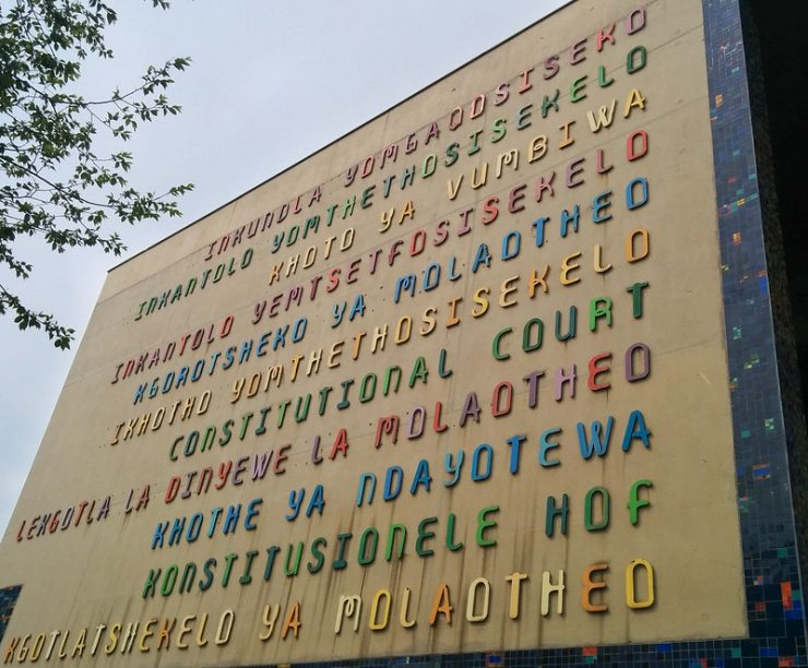 """Constitutional Court"" on the front facade of the Court in all of South Africa's eleven official languages."