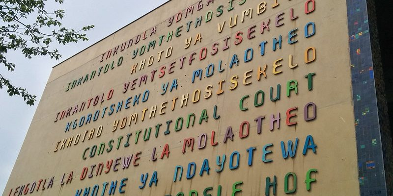 """""""Constitutional Court"""" on the front facade of the Court in all of South Africa's eleven official languages."""