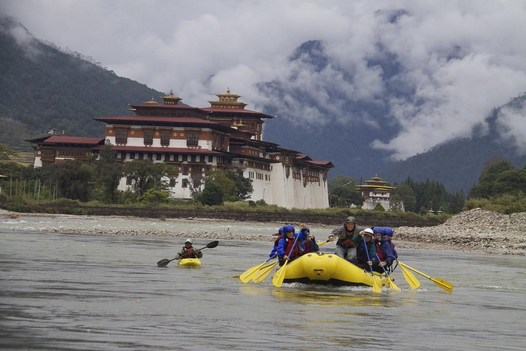 Group of people enjoying river rafting in Bhutan
