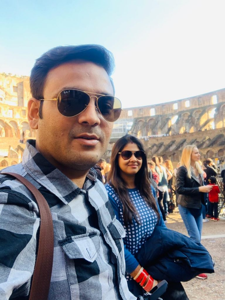 A couple inside Colosseum during their trip to Italy