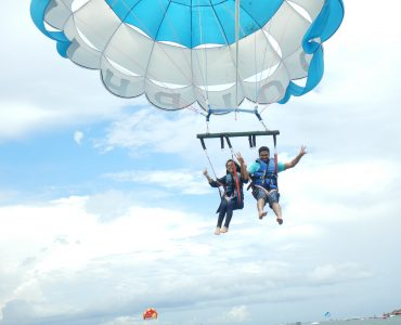 A couple flying high in the skies of Bali