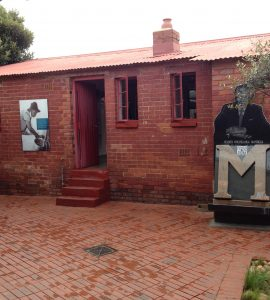 A picture of the red-bricked Mandela House in Soweto