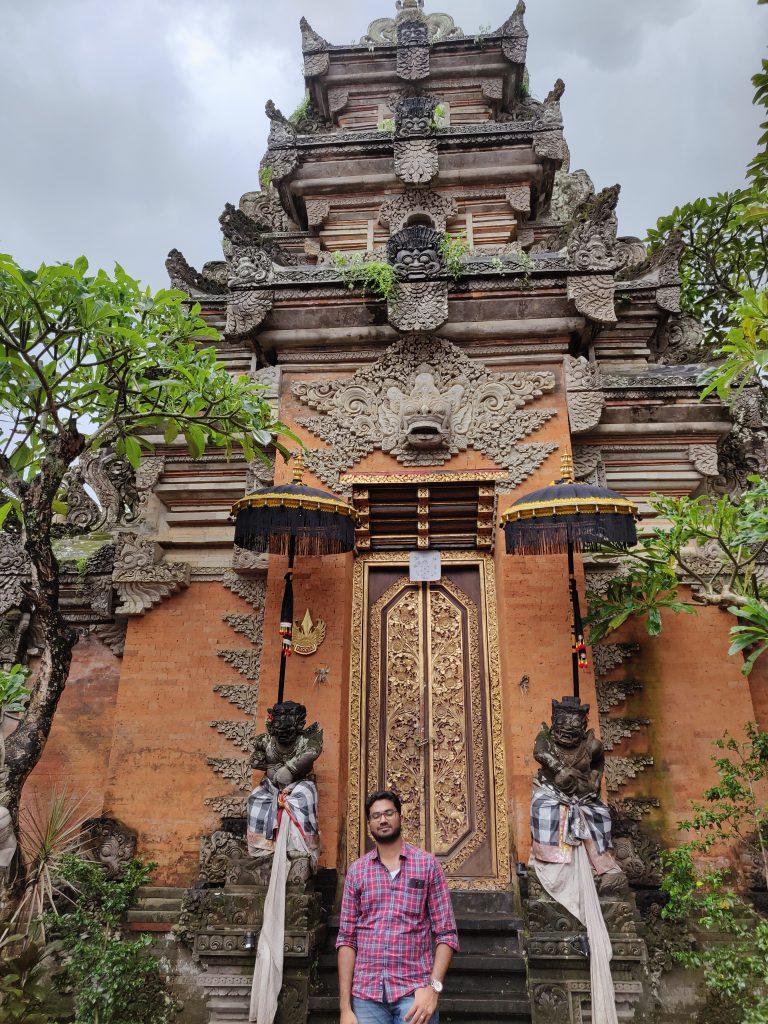 A guy posing in the front of Uluwatu temple in Bali