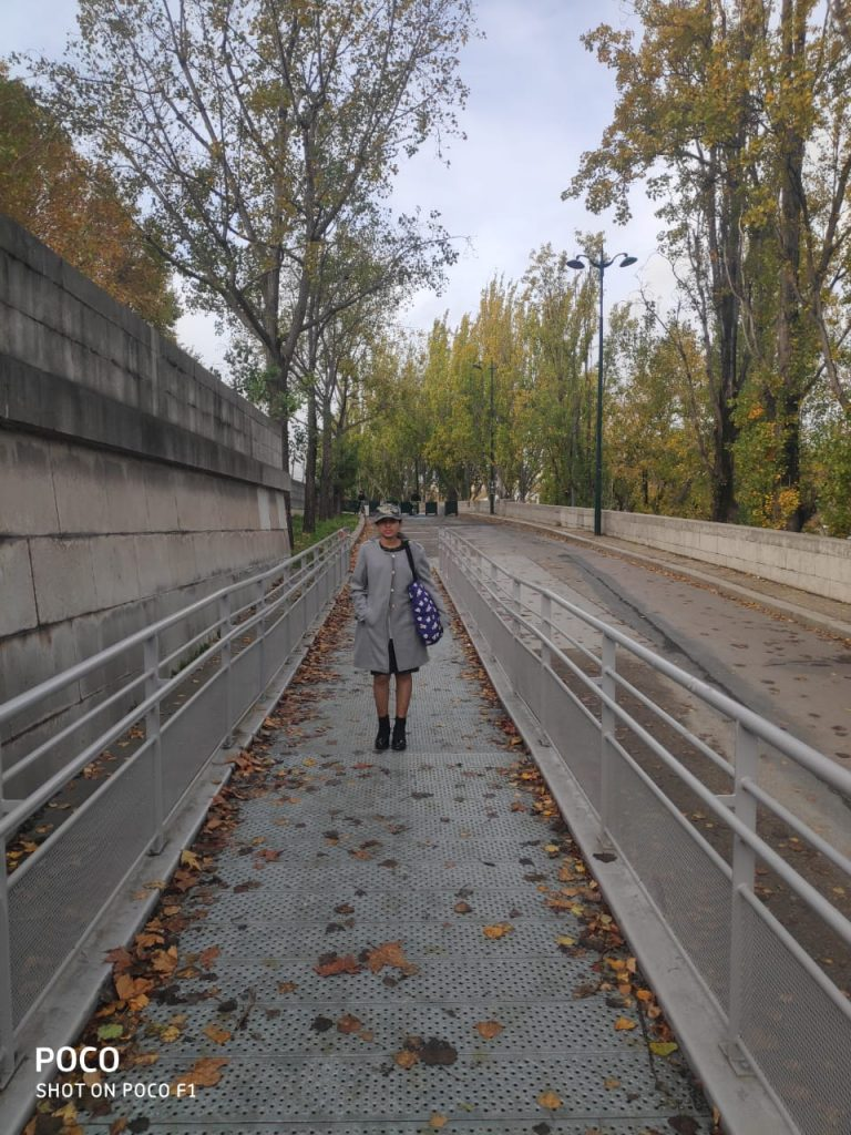 A picture of a girl standing in the picturesque roads of Europe