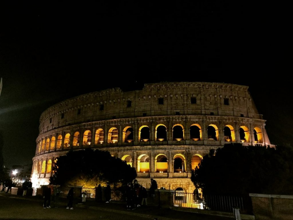 An amazing night view of the Colosseum in lights