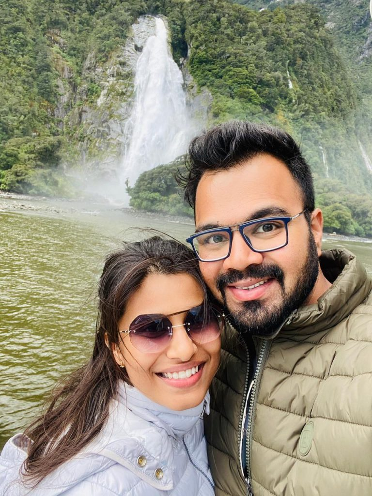 A couple clicking a selfie with waterfalls background