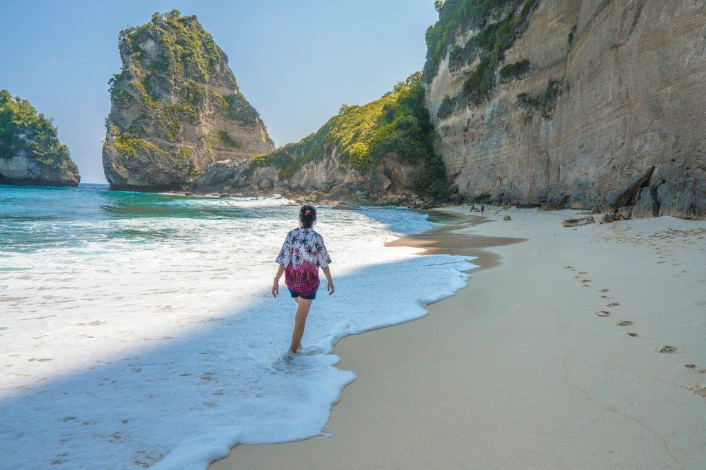 Woman walking in a beach in Nusa Penida