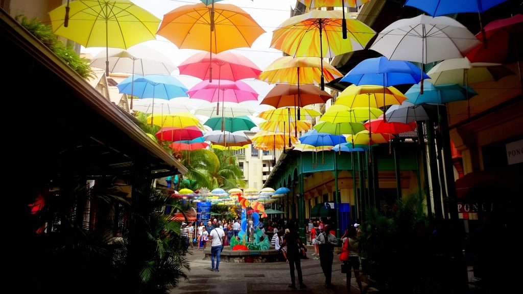 An amazing view of art umbrellas in the street in Port Louis
