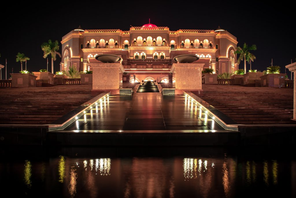 A night view of the Emirates Palace lit up with lights