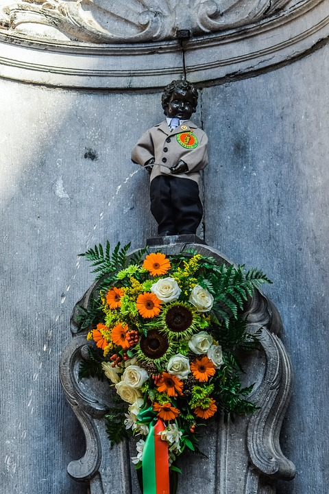 Dressing Manneken Pis in Belgium wearing a suit