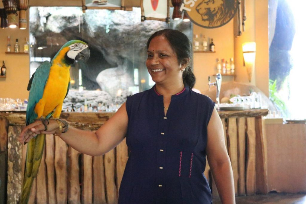 A woman with a parrot at Bali