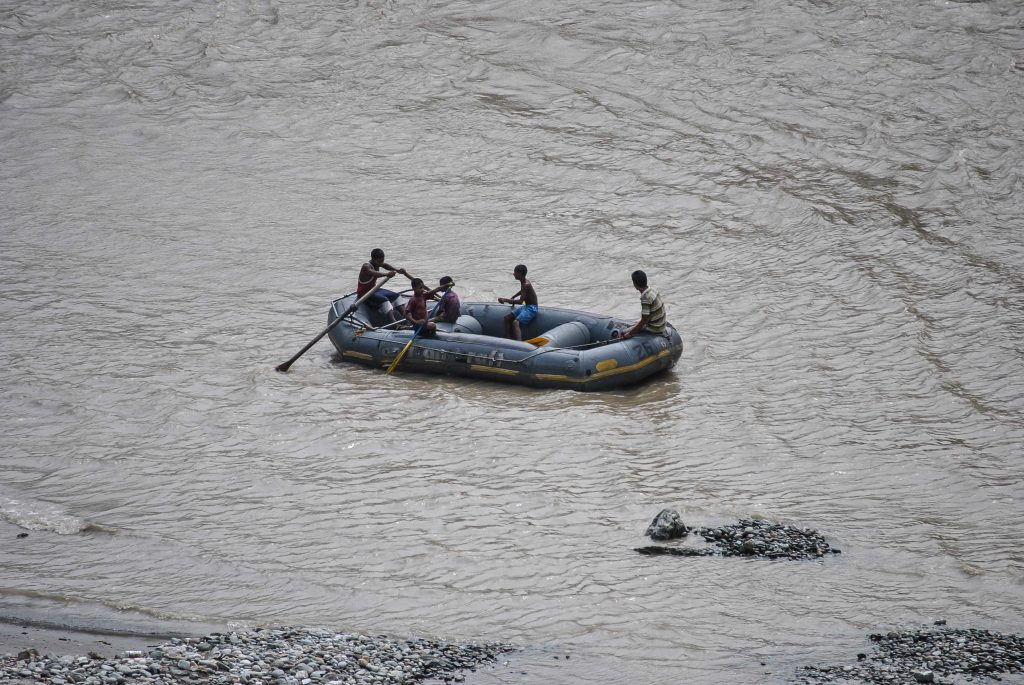 A picture of a group of people enjoying white water rafting in River Teesta
