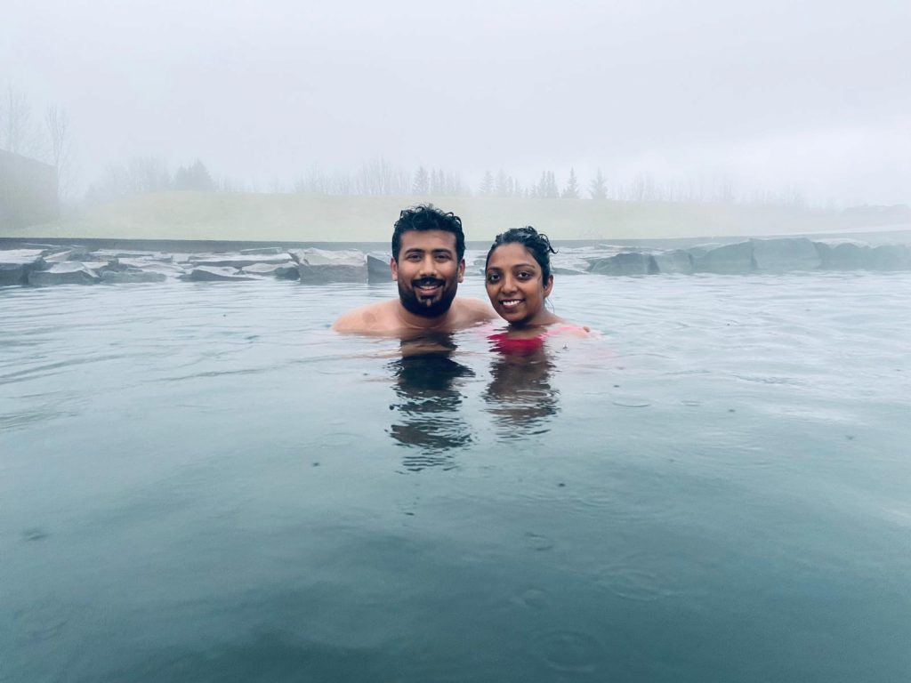 A picture of a couple enjoying Blue lagoon in Iceland