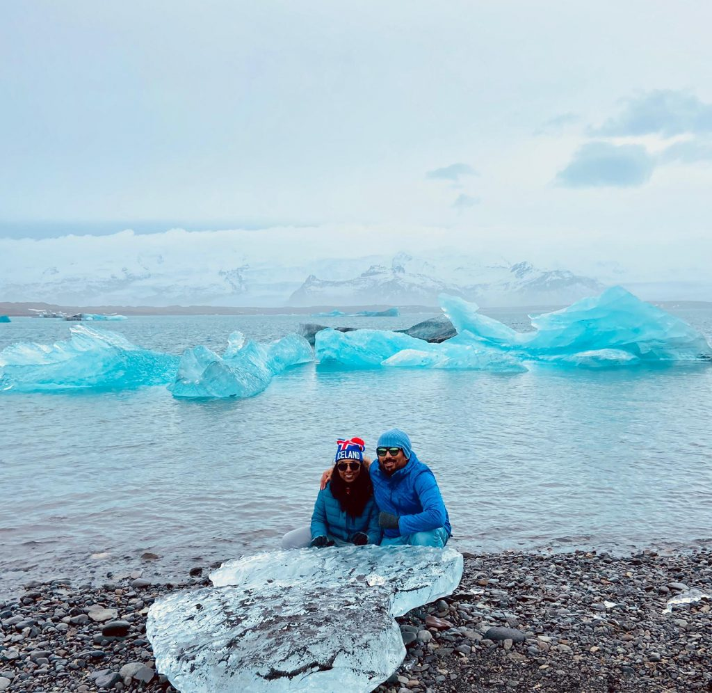 A picture of a couple sitting with ice cubes in Iceland