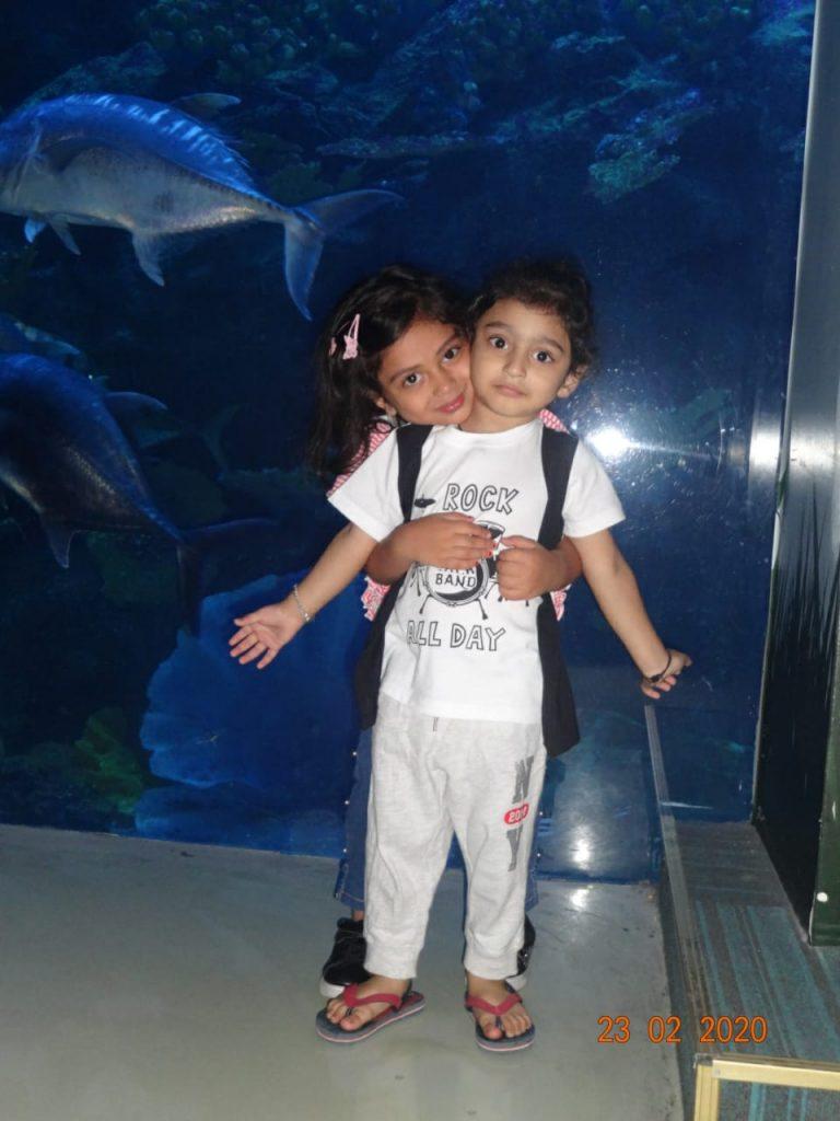 A cute picture of kids posing at the Dubai Aquarium