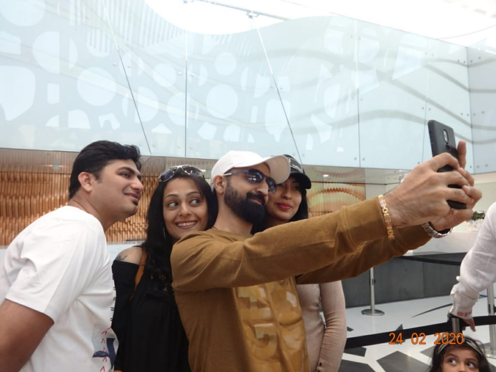 A group of people taking a selfie in Dubai