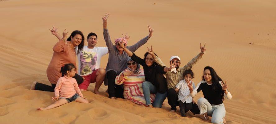 A group of people enjoying at the Desert Safari in Dubai