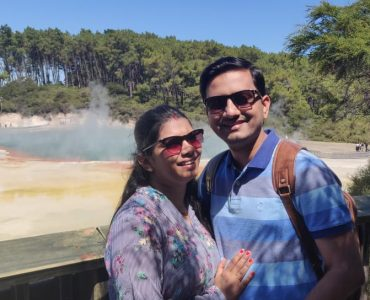 A picture of an amazing couple on their honeymoon vacation to New Zealand