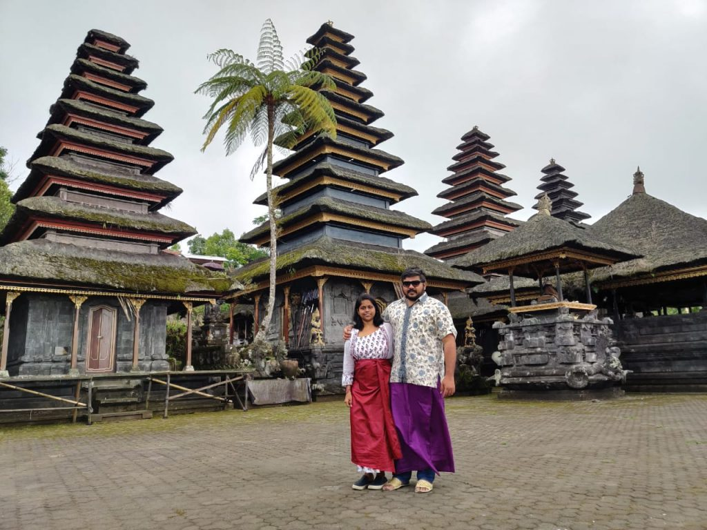 Wearing traditional attire in temple during our trip to Bali