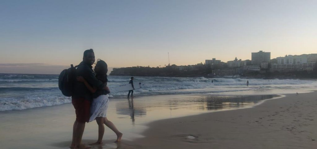 A picture of a couple posing in the beach on their honeymoon trip to Australia