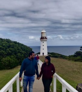 A beautiful picture of a couple with a breathtaking scenery in Australia