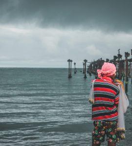 A picture of a man in a beach in Kerala