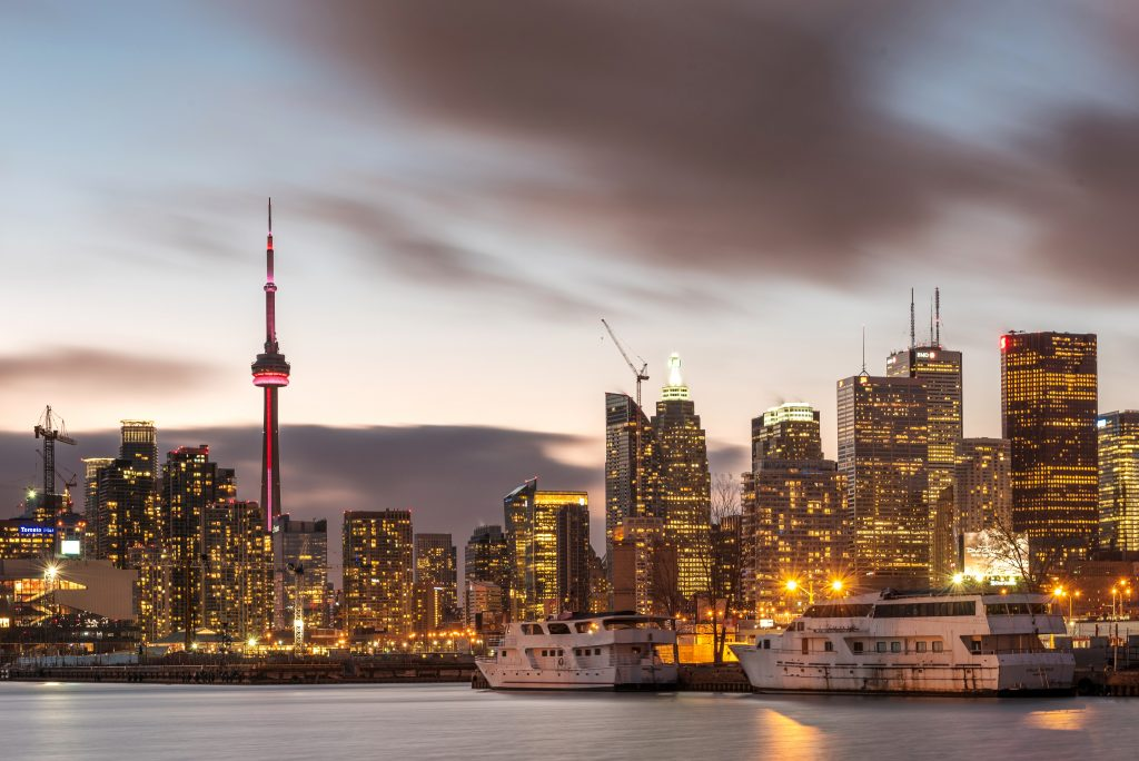 A picture of buildings lit up with lights in Toronto in Canada