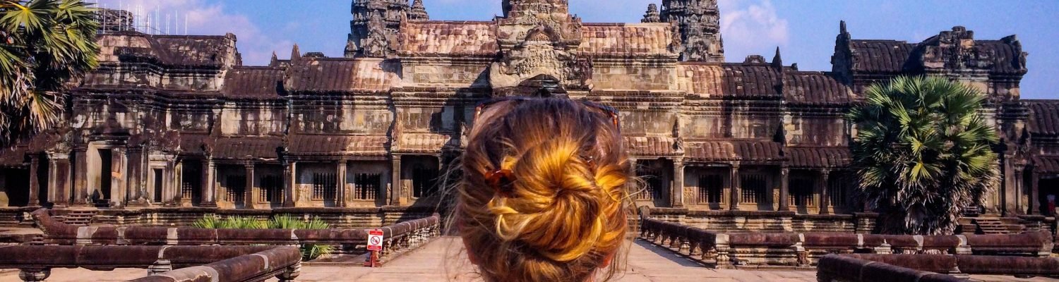 A traveller in front of a famous temple in Cambodia