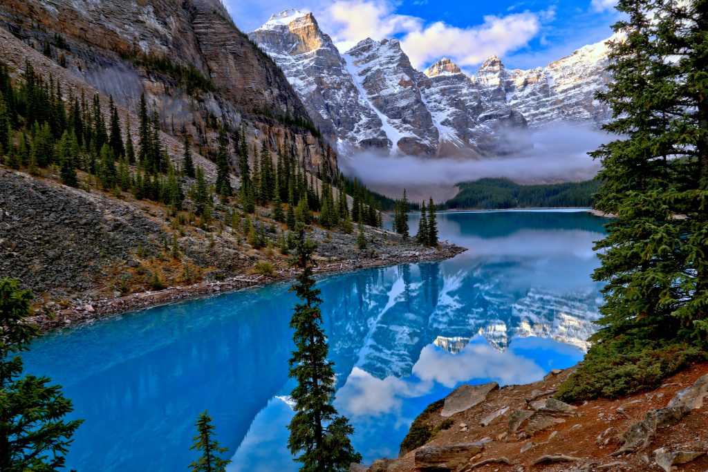A picture of mountains in Banff with a river flowing in between