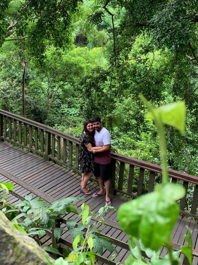 A picture of a couple surrounded by the green beauty in Bali