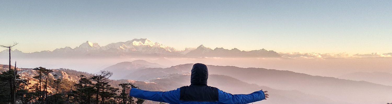 A man enjoying the natural beauty in Darjeeling