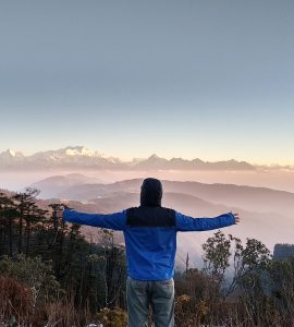 A man enjoying the natural beauty in Darjeeling