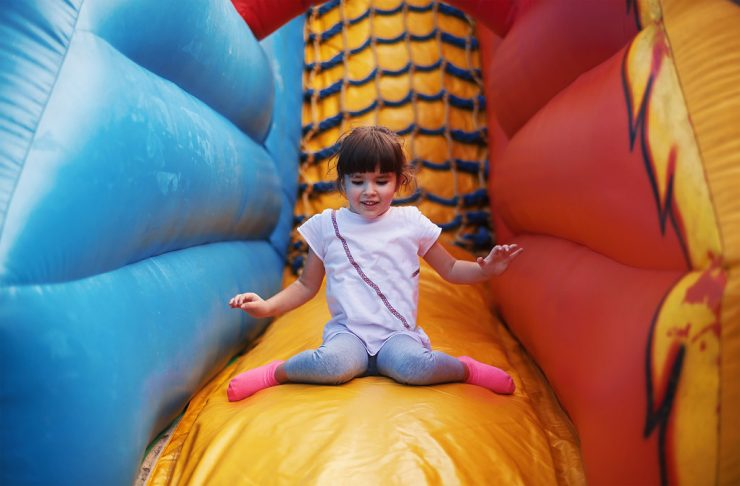 small kid enjoying her bouncing time