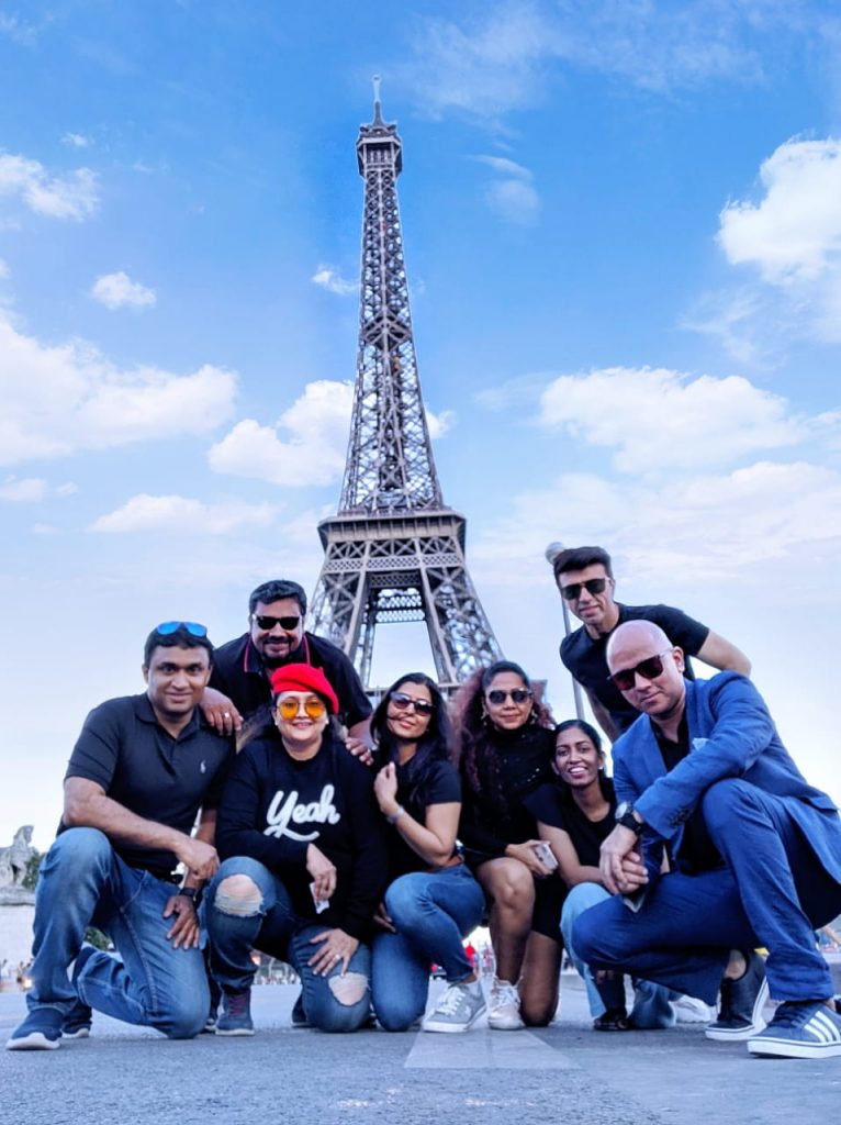 A group of friends with the shining Eiffel Tower as the background