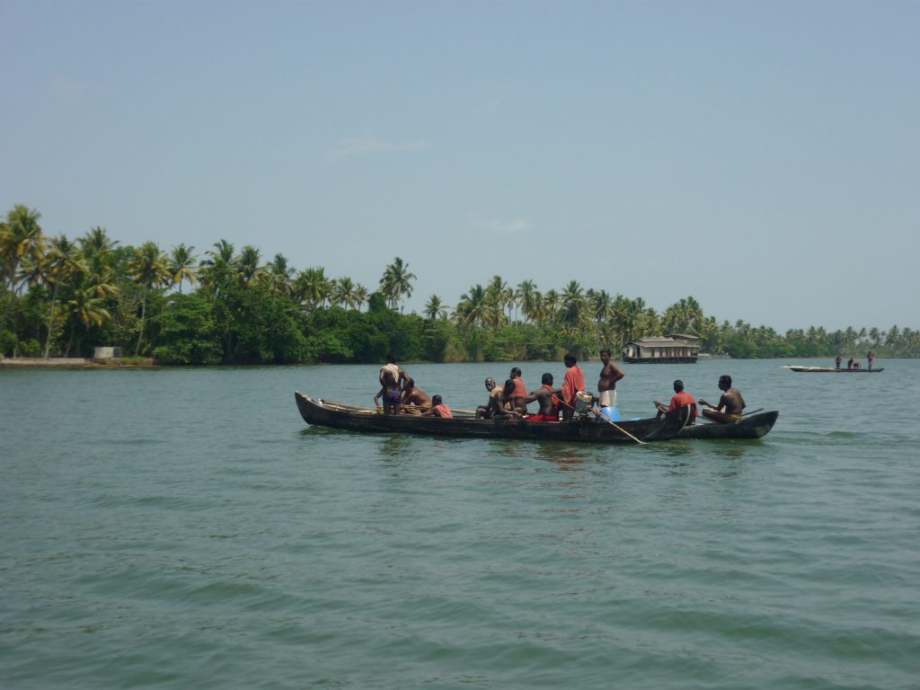 A group of people enjoying a boat ride in Vembanad Lake