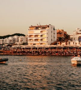 a busy beach in ibiza
