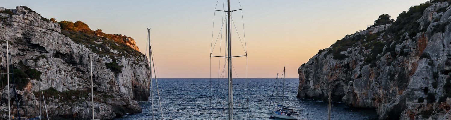 Couple of boats sailing in Menorca