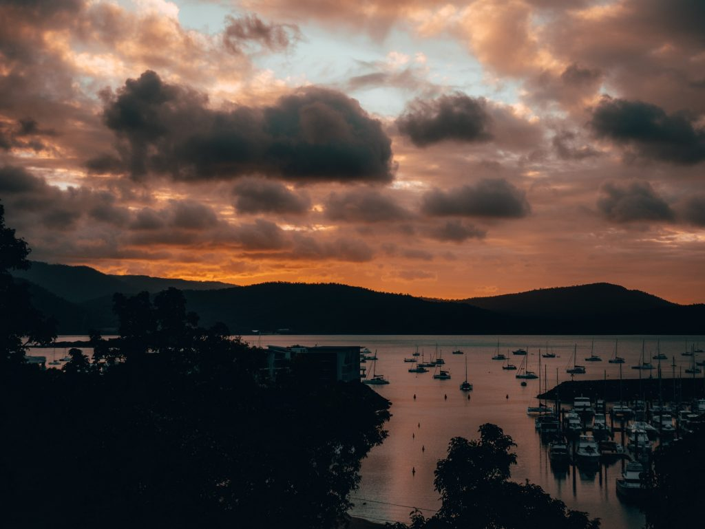 A beautiful view of the sunrise in Airlie Beach, one of the attractions in Whitsunday Islands