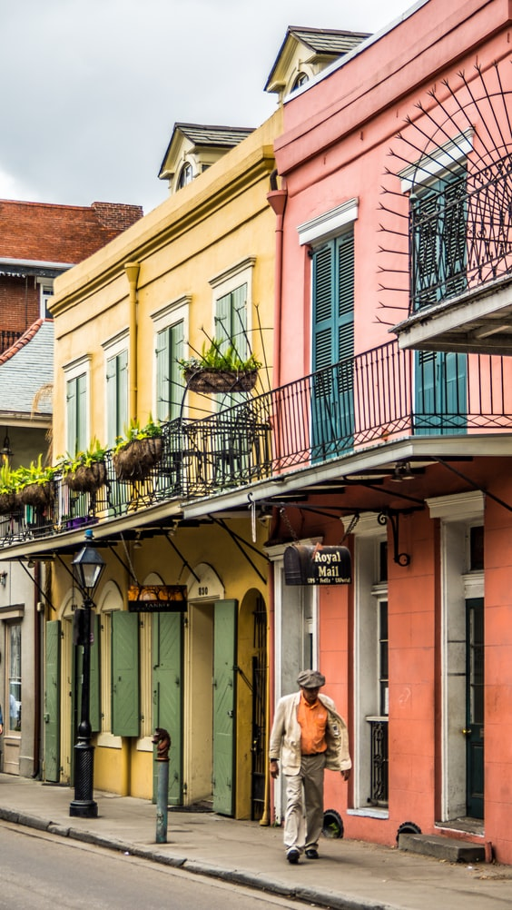 a man walking in the french quarter