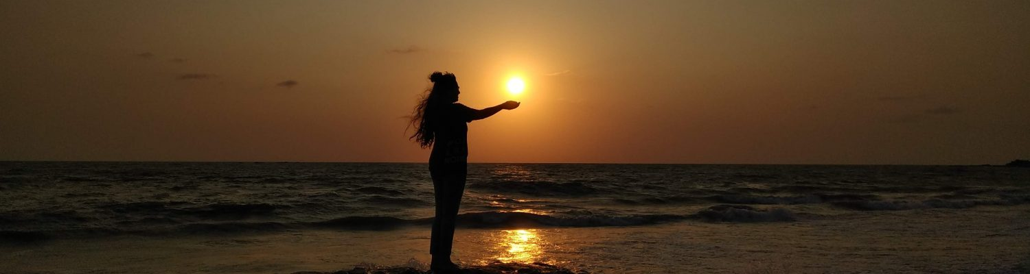 A picture of a girl enjoying sunset in Kerala