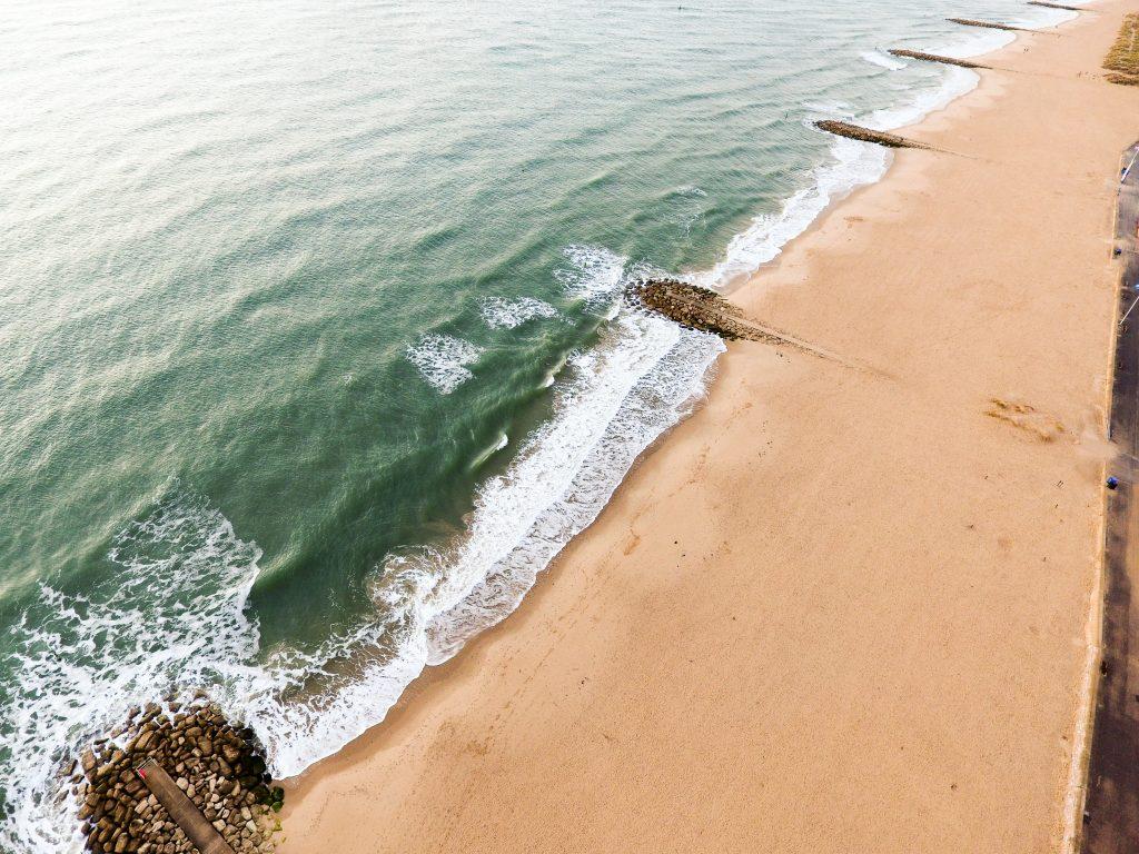 Take a swim in Sandbanks Beach