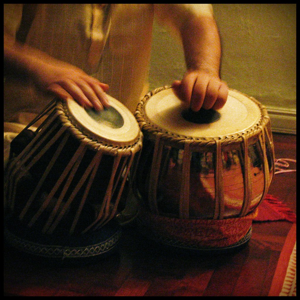 A person playing Tabla