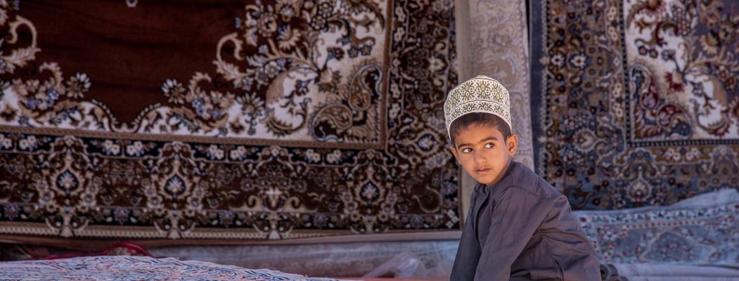 small boy in the attractions in Oman